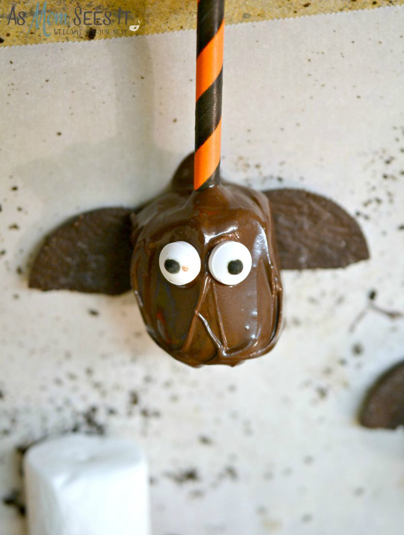 Attaching the wings to your marshmallow bat pop