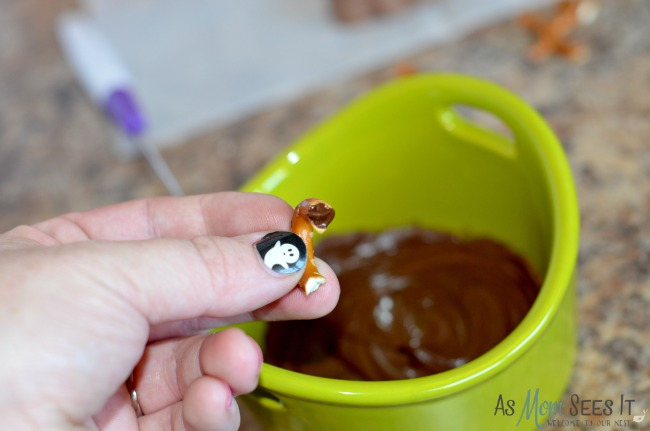Attaching the legs to the Chocolate Halloween Spiders