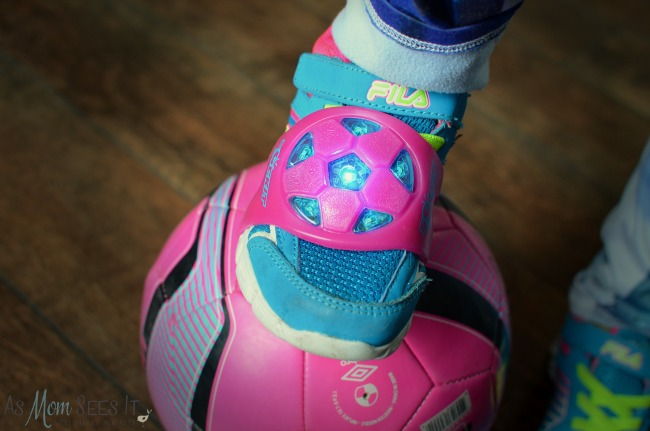 The SockIt slides over their shoes and lights up with a good kick