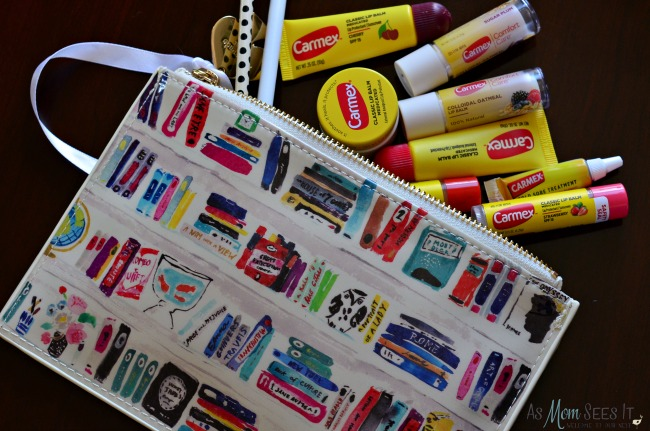 Kate Spade bag filled with Carmex products for the winter