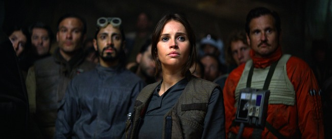Rogue One: A Star Wars Story Jyn Erso (Felicity Jones) in foreground, Bodhi Rook (Riz Ahmed) in background Ph: Film Frame Copyright 2016 Industrial Light & Magic, a division of Lucasfilm Entertainment Company Ltd., All Rights Reserved