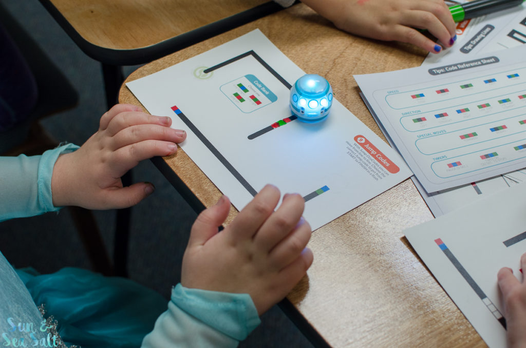 Girl Scouts play with the Ozobot Evo to learn robot coding